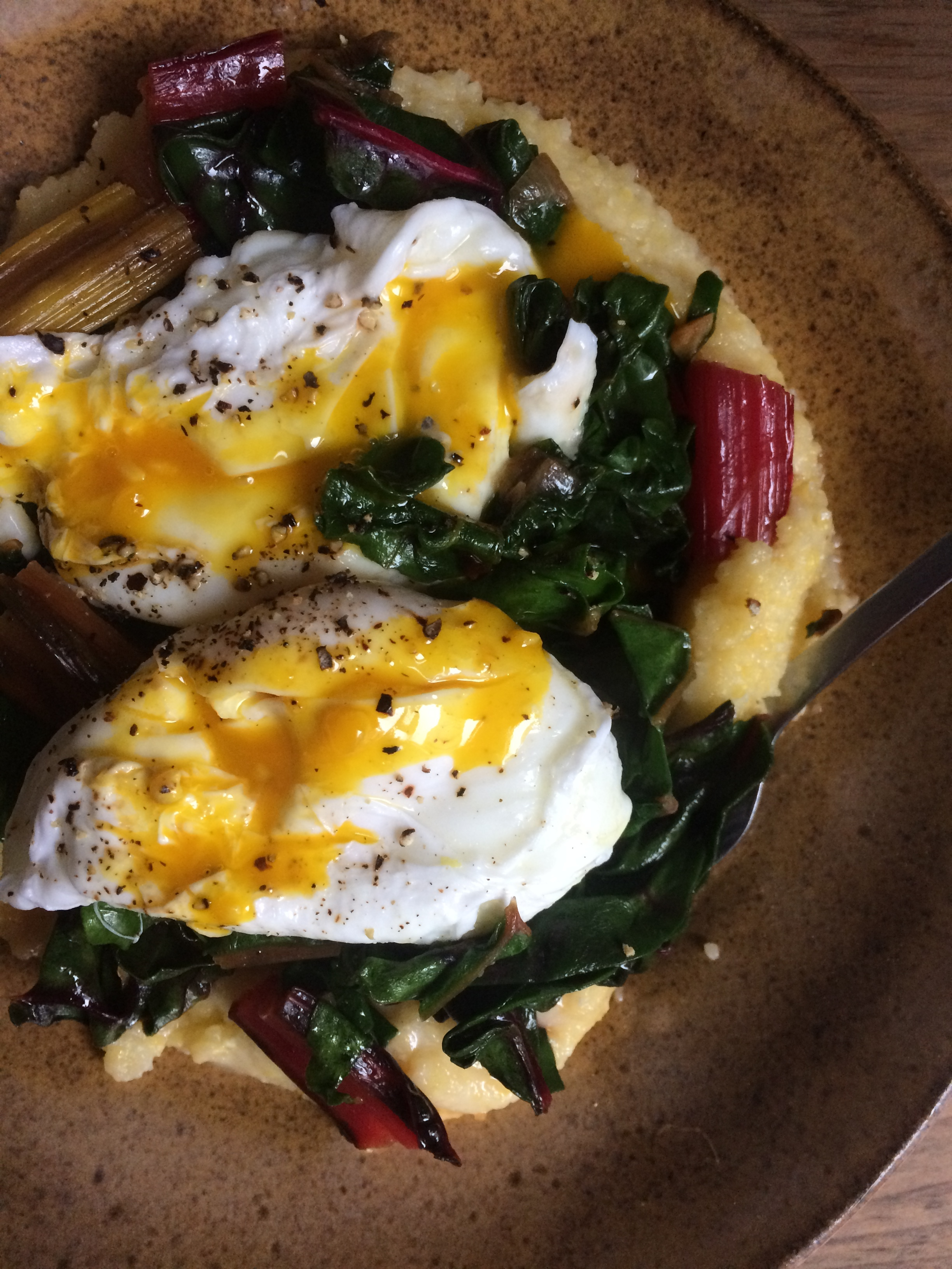 fontina polenta with poached eggs and red chili flakes & garlic swiss chard || planting my roots
