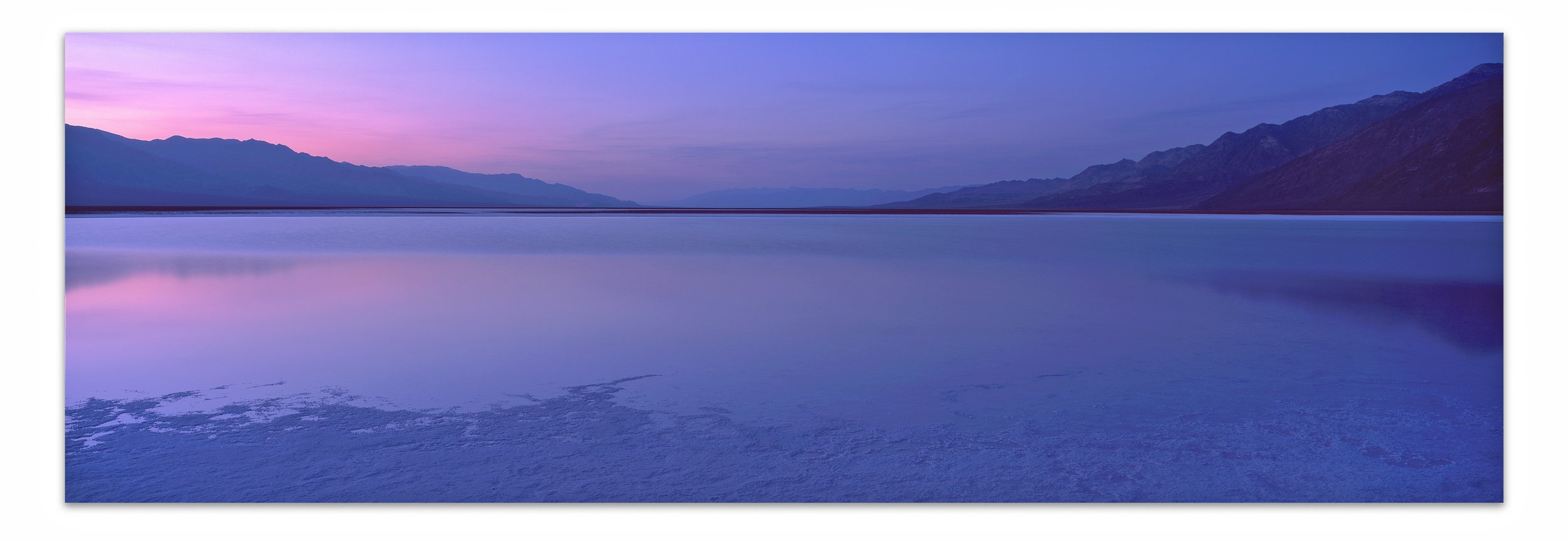 Fade to Blue   | California |  Edition of 11    A moment of reflection near Badwater Basin. Spring rains in Death Valley National Park flooded the park at its lowest point offering an extremely rare glimpse at the hottest and driest location on earth with standing water for nearly 2 weeks during the month of March.    20x60, 24x72, 30x90, 40x120, 50x150 (Panels Only)