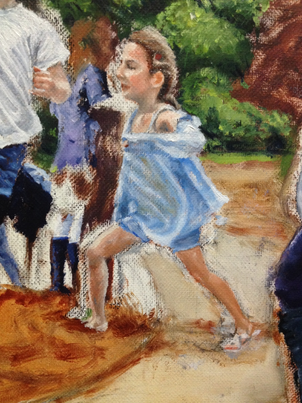 Kid running dressed in blue