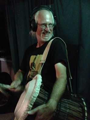 Ian on African Talking Drum at Recording Session. (Photo by Paul Miller)