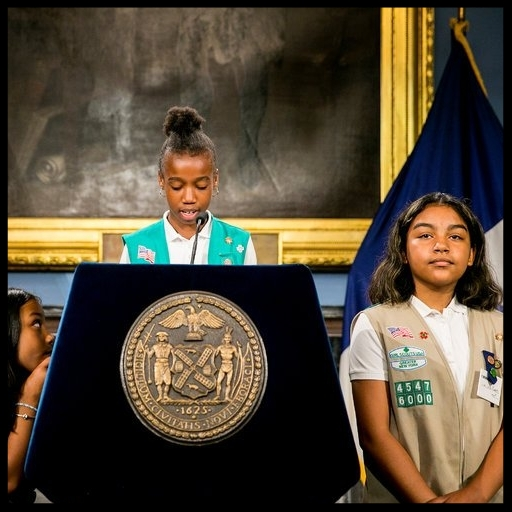 Members of Troop 6000, a Girl Scouts group based in a homeless shelter in Long Island City, at a news conference announcing the expansion of the program to 14 other shelter sites.  Credit: Sam Hodgson for The New York Times