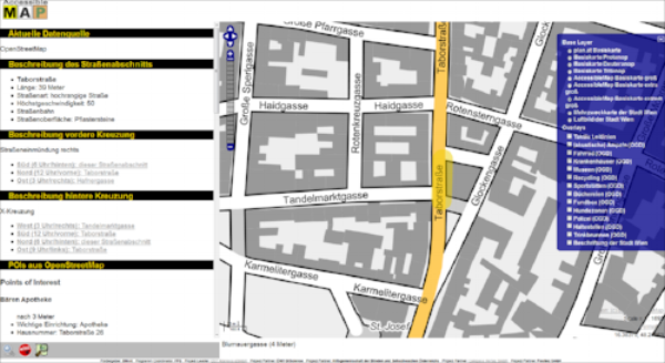 The screenshot shows a view of the AccessibleMap next to textual descriptions of the street and next corners, as well as possible points of interest in the near surrounding such as a pharmacy.