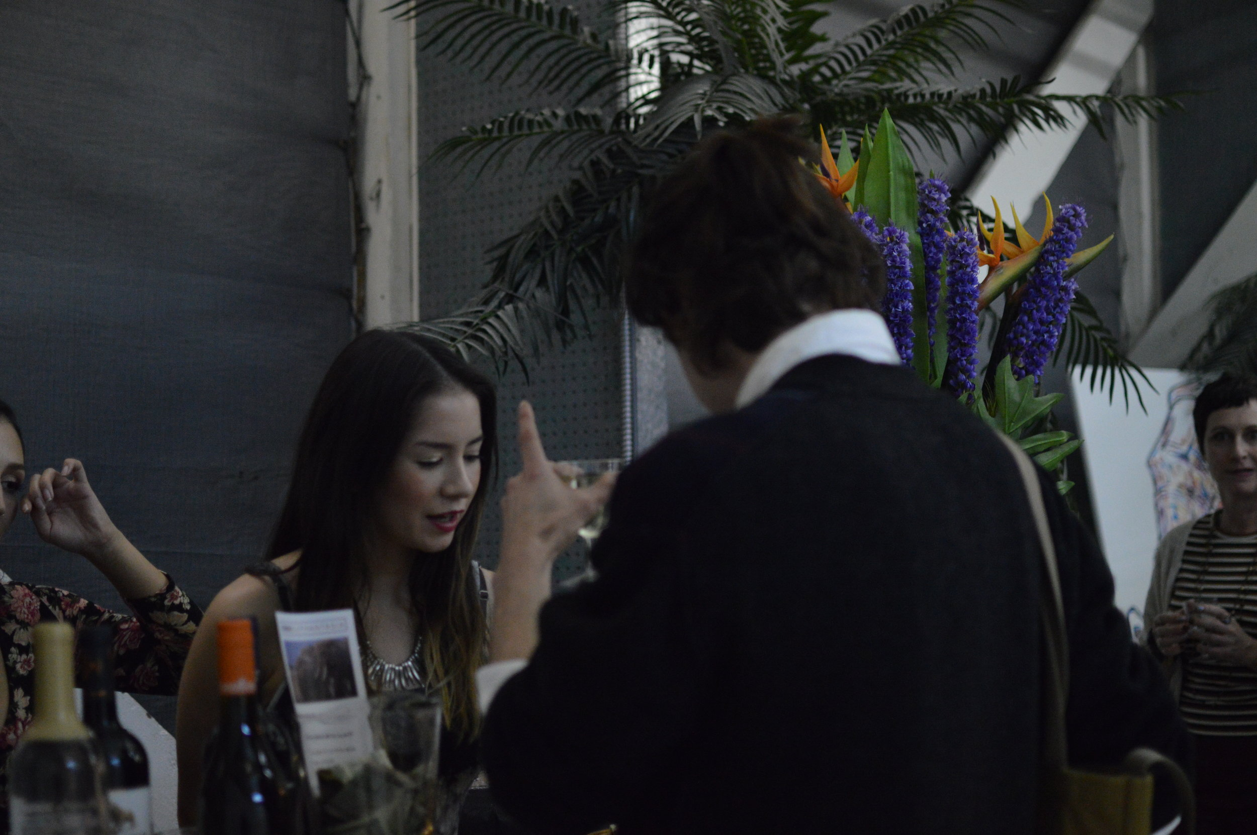 Open bar of organic wine, cocktails and hors d'oeuvres.