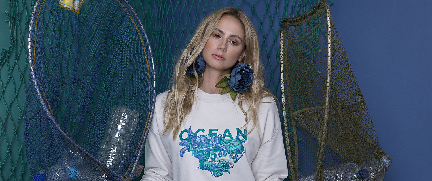 """Featured sweater by UK brand,  Gung Ho.  This season their focus was """"Plastic Pollution,"""" and they aim to encourage people to engage with important issues such as ocean pollution."""