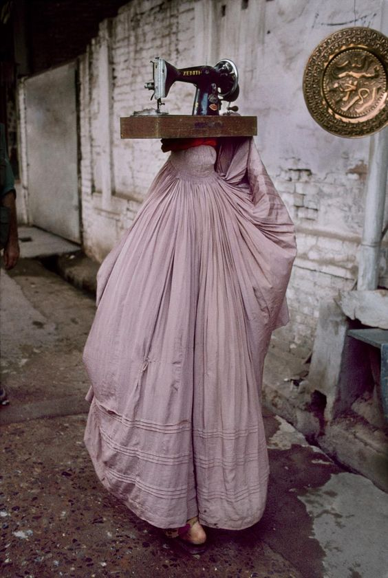 Photo by  Steve McCurry  of a woman in Peshawar, Pakistan