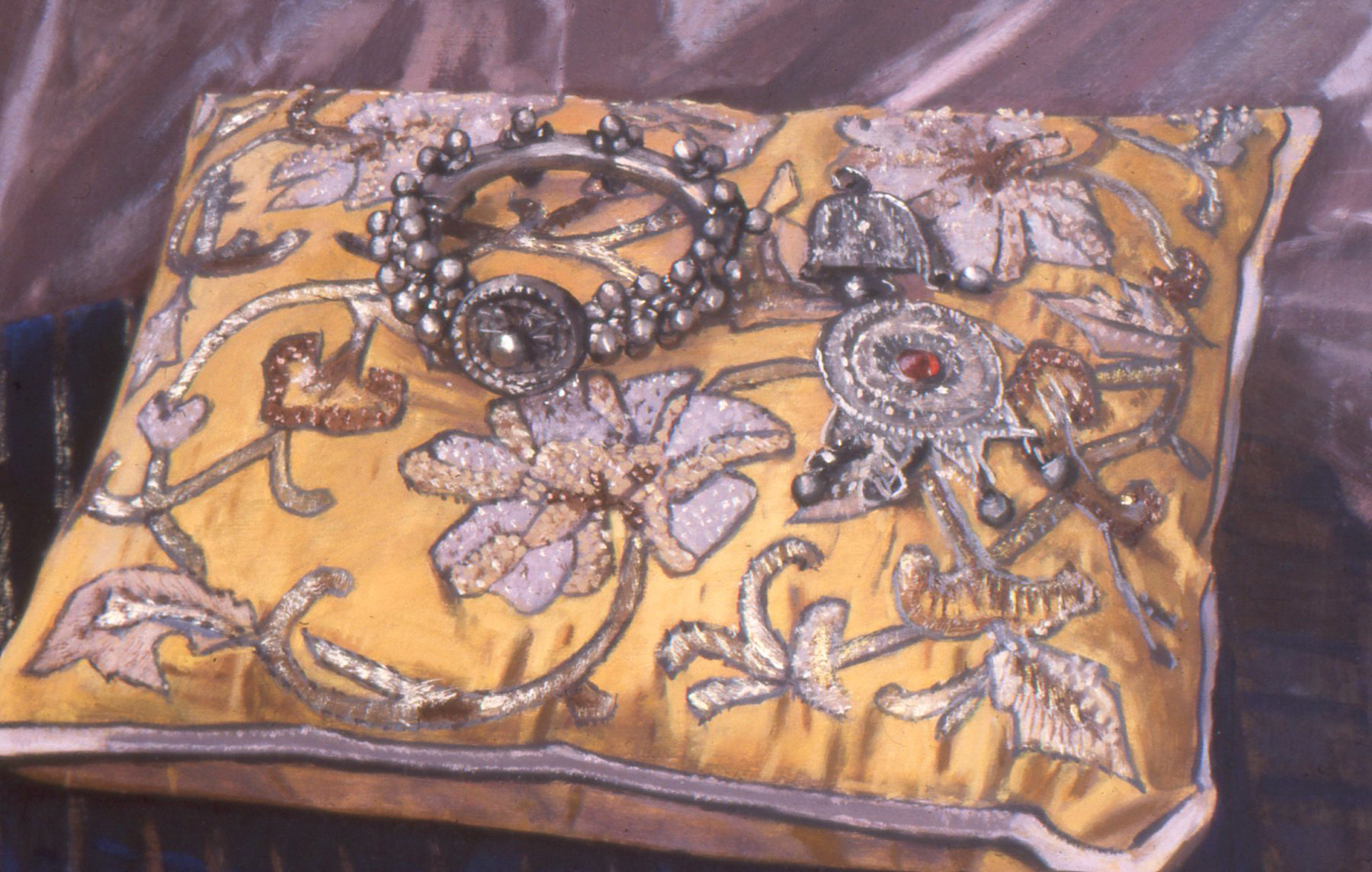 Silver bracelet on a richly embroidered cushion
