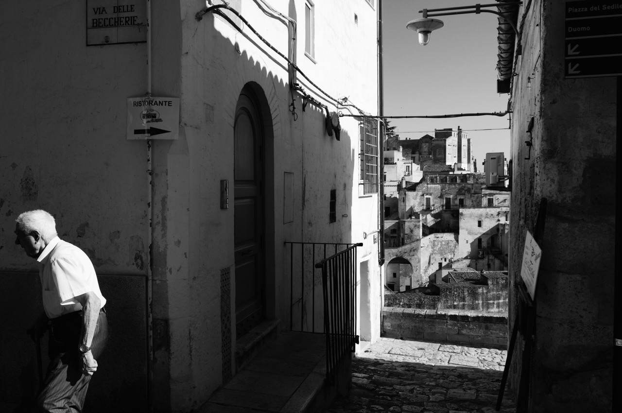 Old man walking in the streets. Matera. Italy.2016.© Michele Cortina
