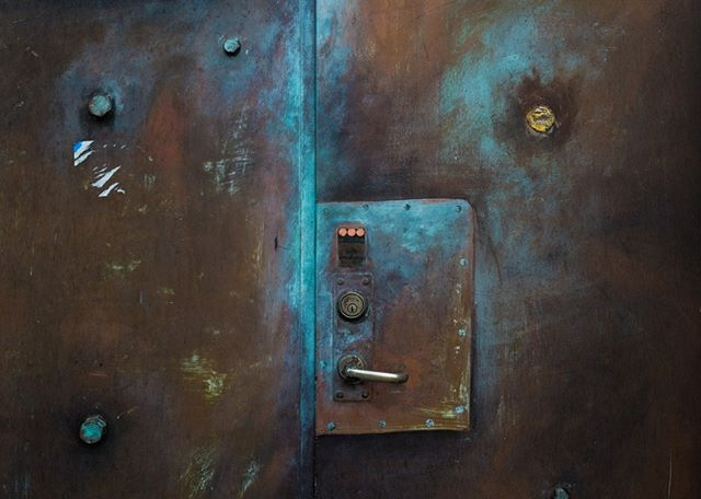 Morning shower The air made humid by rain Rusted door stares  #haiku #texture #stockholm #door #leicaq