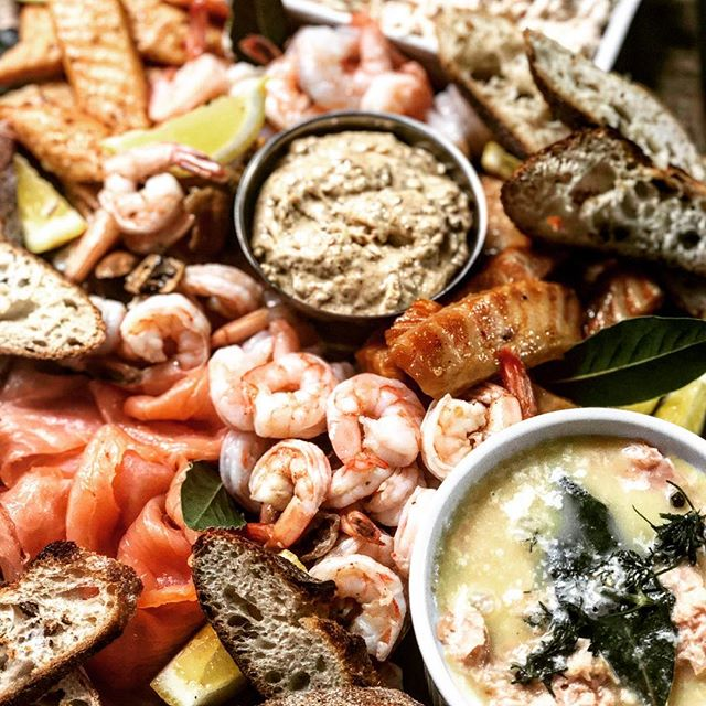 Abundance platters ! Seafood addition 🌊 Salmon rillettes, potted crab, candied trout, gravlax, preserved lemon prawns and cold shrimp with harissa cocktail. Chilled w a buttery chard and perfect for a summer soirée! (If our 7th winter ends soon) 🙄 #torontocanada #torontocatering #torontocaterer #eatleafandbone #scratchmade #housemade #getnatural #eatwell #abundanceplatters #plentiful #leslieville #riverdale #riverside #seafoodtime #summer #soiree @bbirdco baguettes the best !