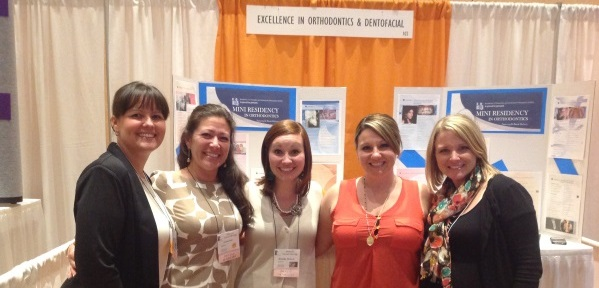 The Exhibit Hall was full of smiling faces. Pictured here: Dr. Michael Agnini's Team.