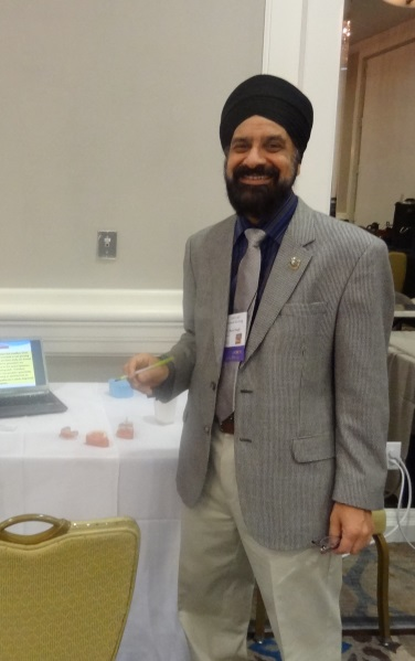 Dr. Singh presents a Table Clinic.