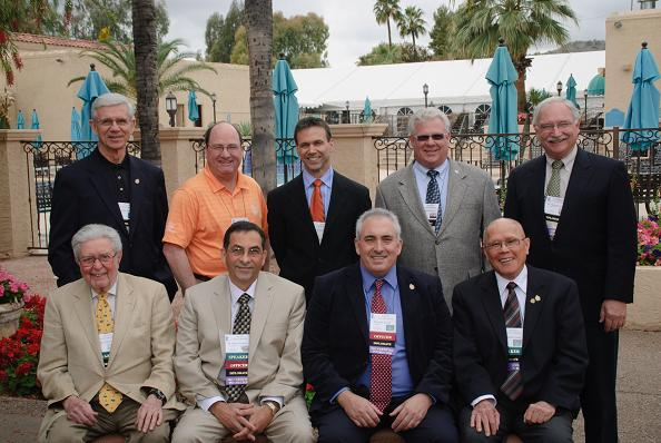 IAO Members pose for a picture, including (from left, second row): Drs. John Baar, Tom Hughes, Brian Billard, Reuel Owen, Milt Pedrazzi, (first row) Sylvan Morein, Alvin Cardona, Cary Fraser, & Richmond Cheng