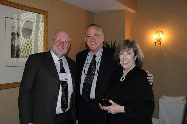 Former AAFO President Dr. Craig Stoner (left) poses with Past IAO President Dr. Sam Beavers and his wife, Cynthia Beavers