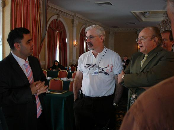 Dr. Derek Mahony (left) receives questions after his presentation at the IAO Annual Meeting