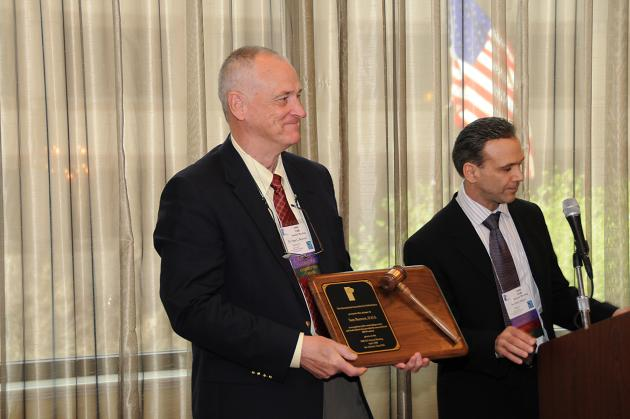 Dr. Sam Beavers (left) gratefully accepts his Past President's Plaque from current IAO President, Dr. Brian Billard (right)