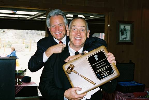 IAO President Dr. Sam Beavers received the gavel from IAO immediate past president Dr. Ken Gasper, but is less eager to pass on the immediate past president plaque to Dr. Gasper