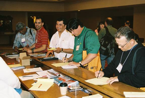 IAO Annual Meeting participants turning in their course credit participation sheets