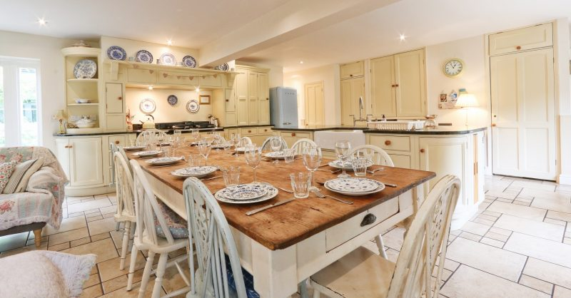 The large Antique Farmhouse kitcheN Table seating 12-14 people took us years to find and replaces a smaller similar table. It was sourced from a local antiques auction