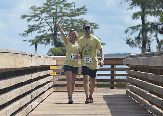 Over 150 walk/run participants completed the Lake Waccamaw State Park section of the 16-mile route over the new pedestrian bridge at the dam.