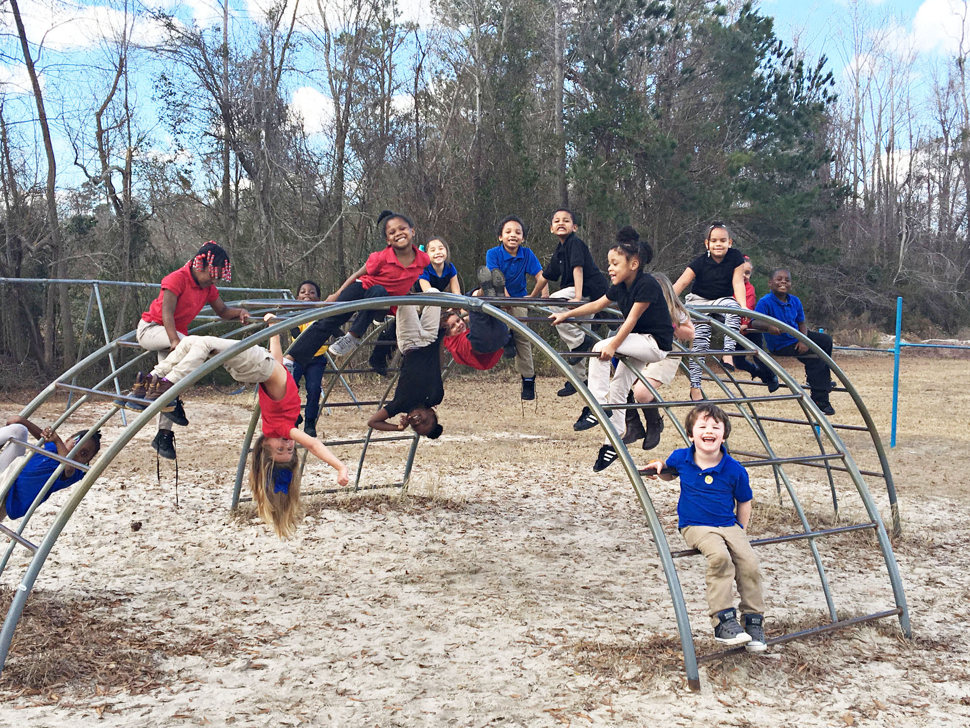 Rebecca Owens' kindergarten class enjoys a sunny day on the playground at Whiteville Primary School