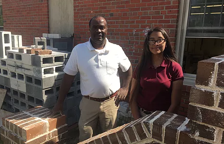 Columbus Career & College Academy masonry instructor Fred Mason and student, Rossy Ballesteros, a finalist in the Build Your Future contest.