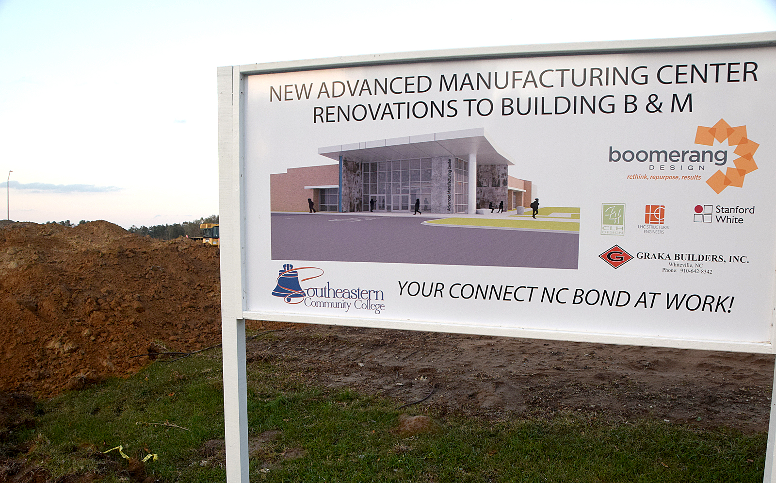 A sign by the site features a rendering of the Advanced Manufacturing Center under construction at SCC.
