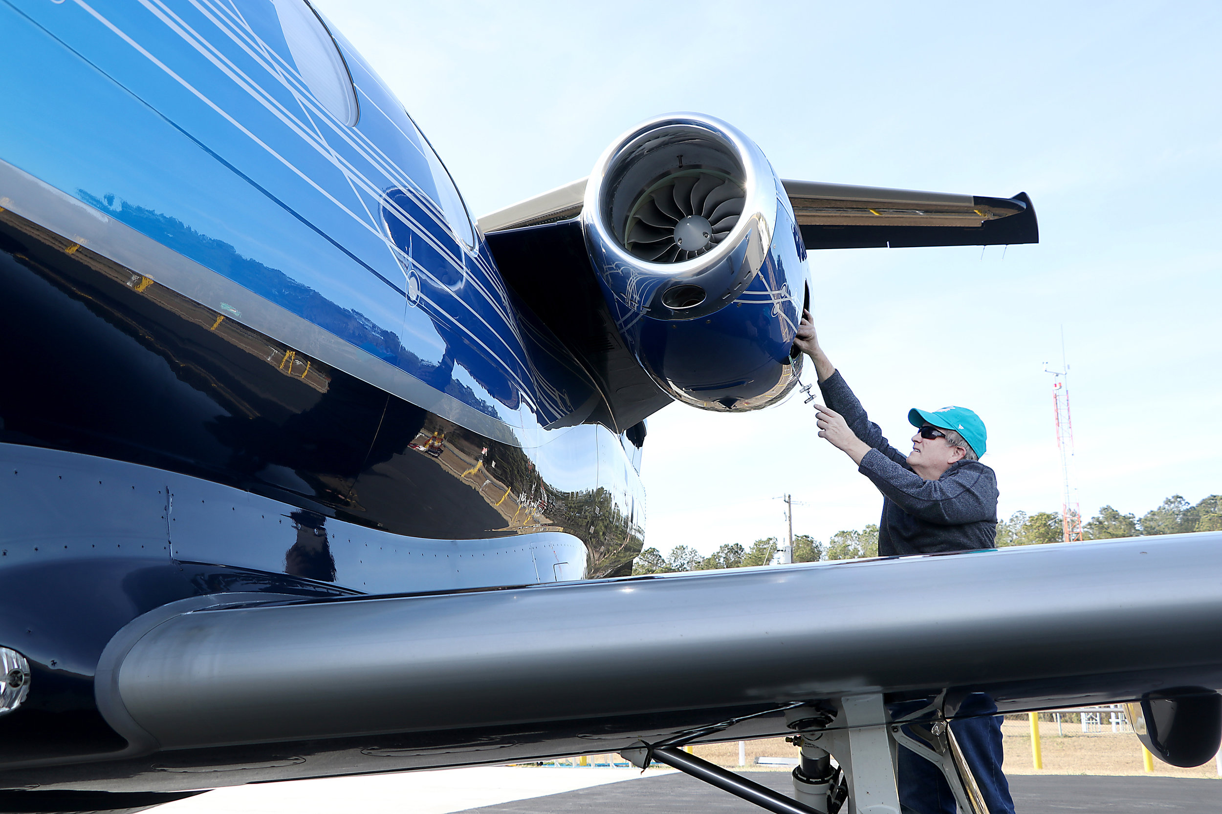 Gary Strausser of Pennsylvania checks his Embraer jet at the Columbus County Municipal Airport