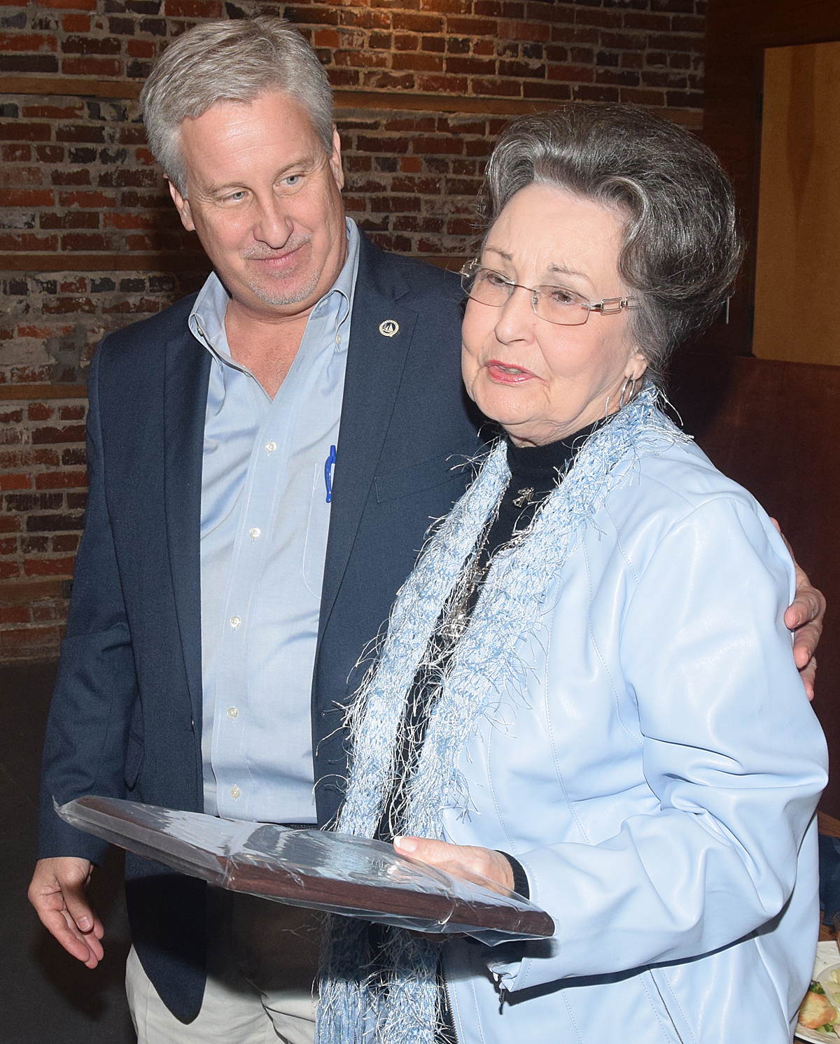 Tabor City Committee of 100 President Trent Burroughs with Martha Jo Garrell, wife of the late Jimmy Garrell, long-time chairman of the group