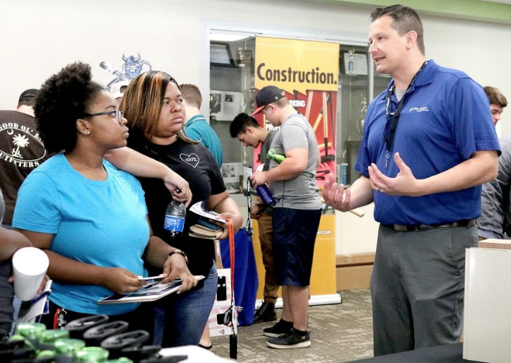Plant Manager Tony Rogowski of Cornerstone Building Brands explains how his company in Fair Bluff operates to students at the Advanced Manufacturing Job Fair in the Nesmith Student Center at Southeastern Community College Thursday.