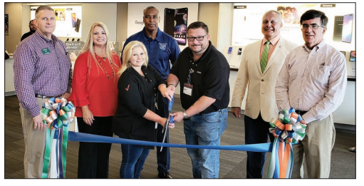 Manager Jason Barnes and Assistant Manager Whitney Hannah cut the ribbon at Victra Verizon Wireless Thursday during a Columbus Chamber of Commerce and Tourism ribbon cutting. Also pictured, from left, are Chamber Chair Jamille Gore, Chamber President Jennifer Holcomb, County Commissioner Jerome McMillian, Whiteville City Manager Darren Currie and Whiteville Mayor Terry Mann.