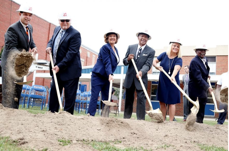 Members of the Whiteville City Schools Board of Education participate in a groundbreaking ceremony Thursday morning for a new building at Whiteville High School.