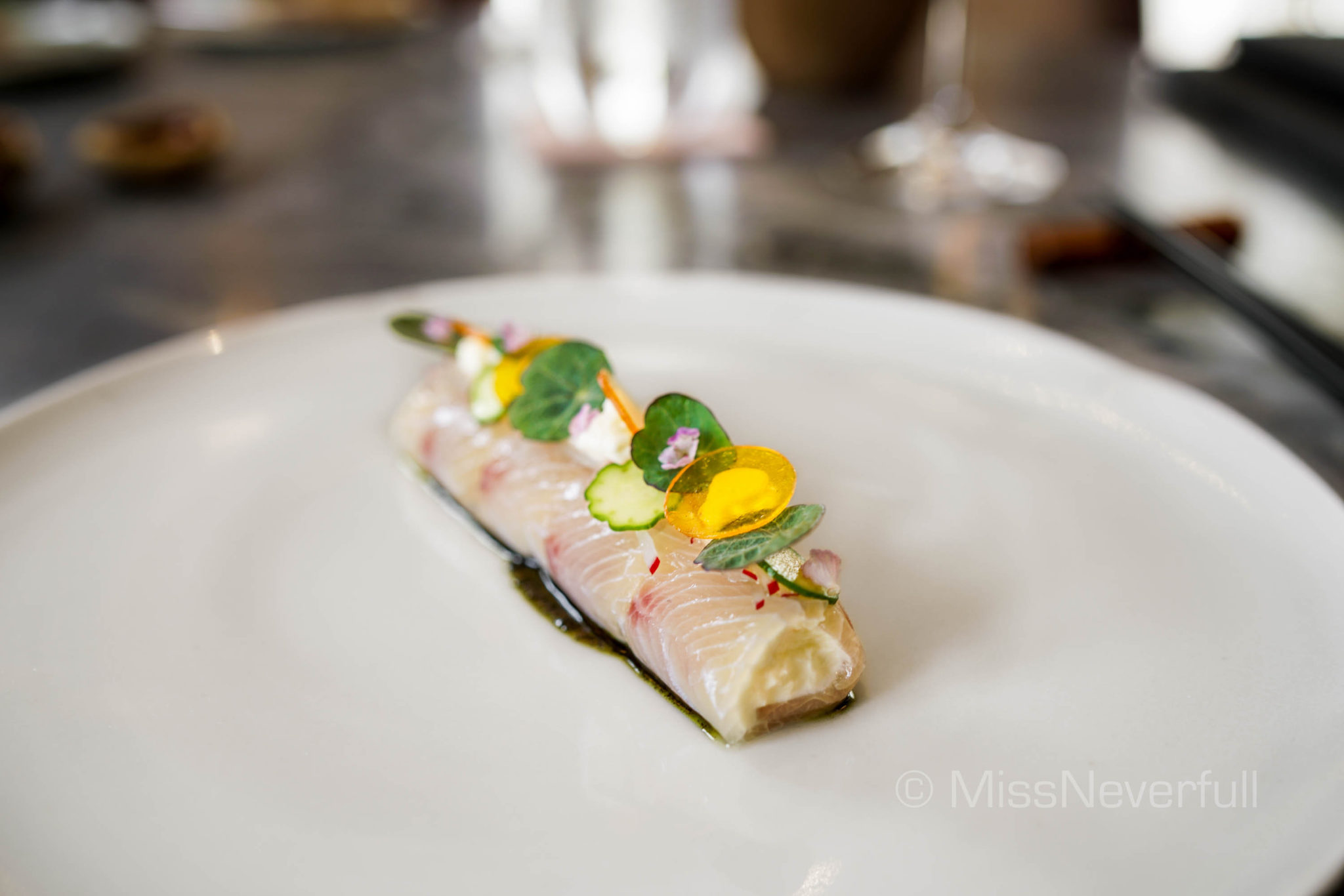 Sashimi of yellowtail Amberjack, lime crème fraîche, dashi jelly, white soy dressing