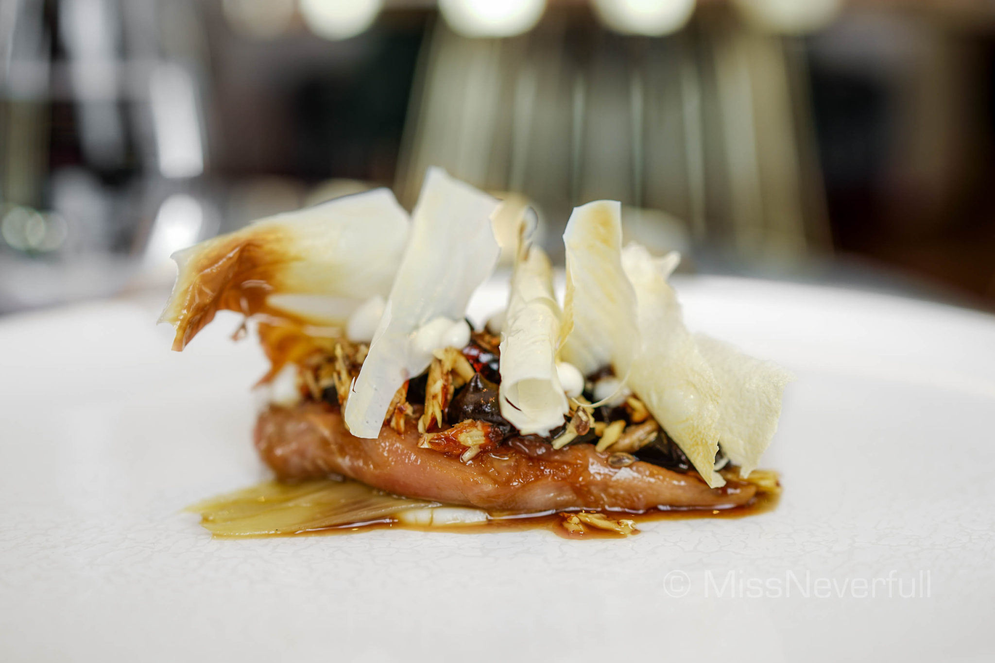 Butter poached quail breast, toasted nuts and seeds, century egg, black garlic, endive heart, roasted milk skin