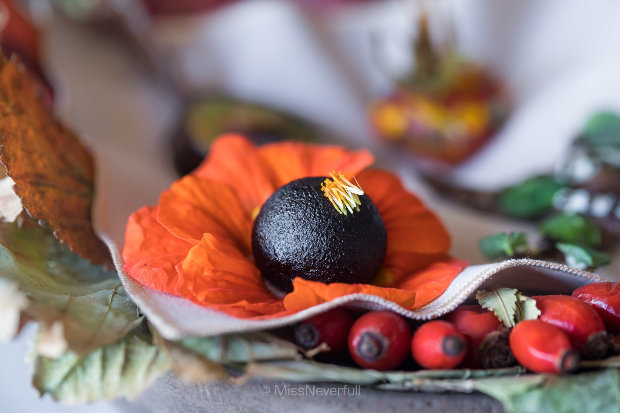 Nasturtium stuffed with black currant berry