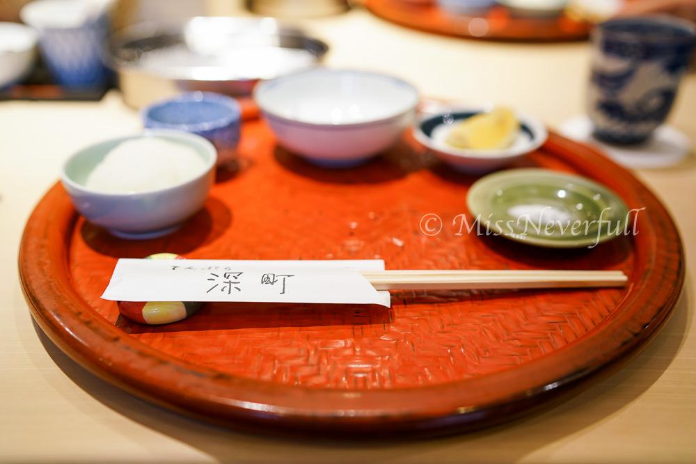 On the table: grated radish, empty bowl for left overs, tempura sauce, lemon and sea salt.