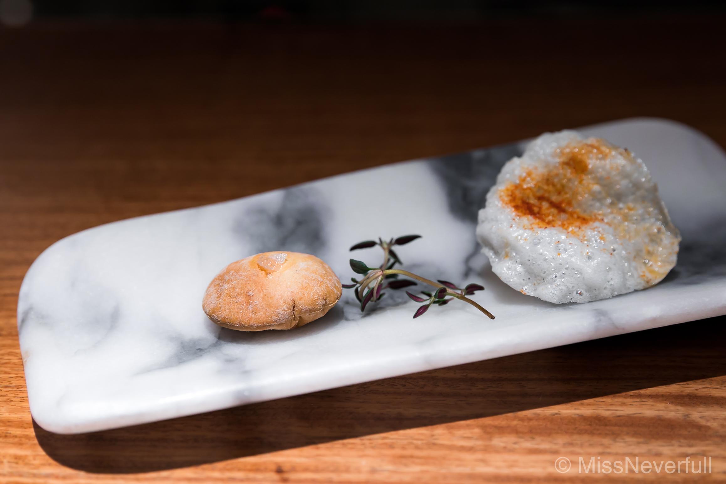 Amuse Bouche: Tomato and olive oil Petit Pain, Paprika rice crisp