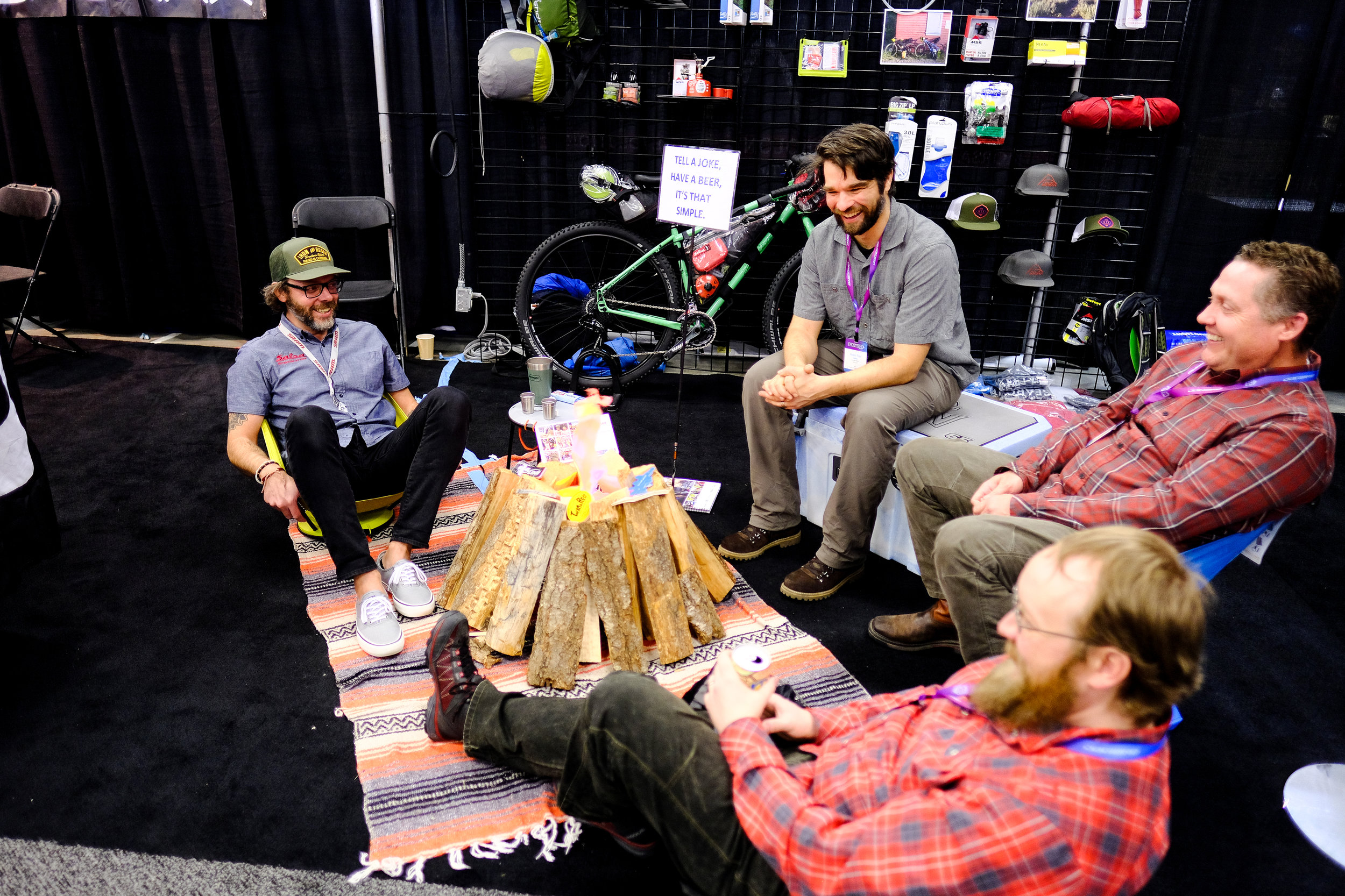 These guys have trade shows figured out: Tell them a joke, they give you a beer! Plus campfire.