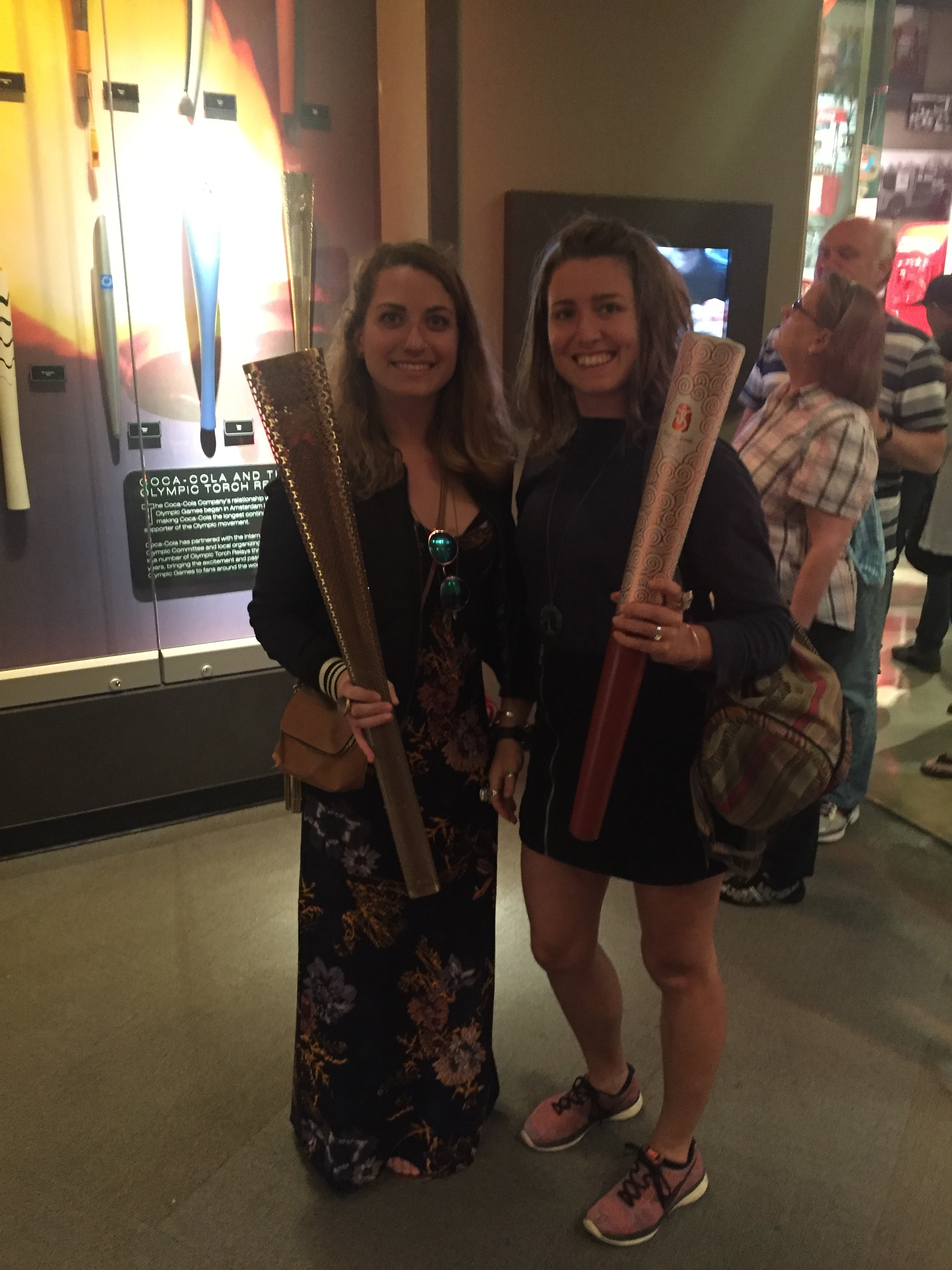 We're holding OLYMPIC TORCHES!