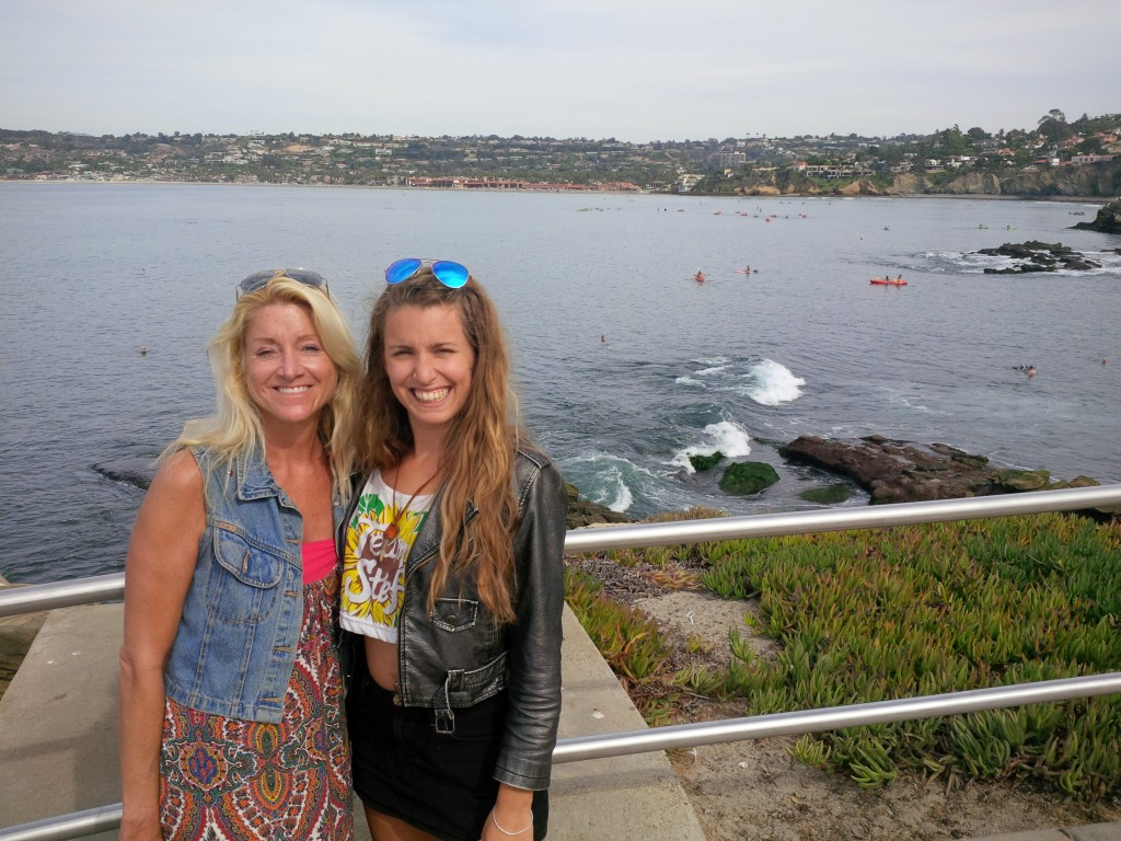 Diane and I in lovely La Jolla, posing with the snorkelers and sea lions.