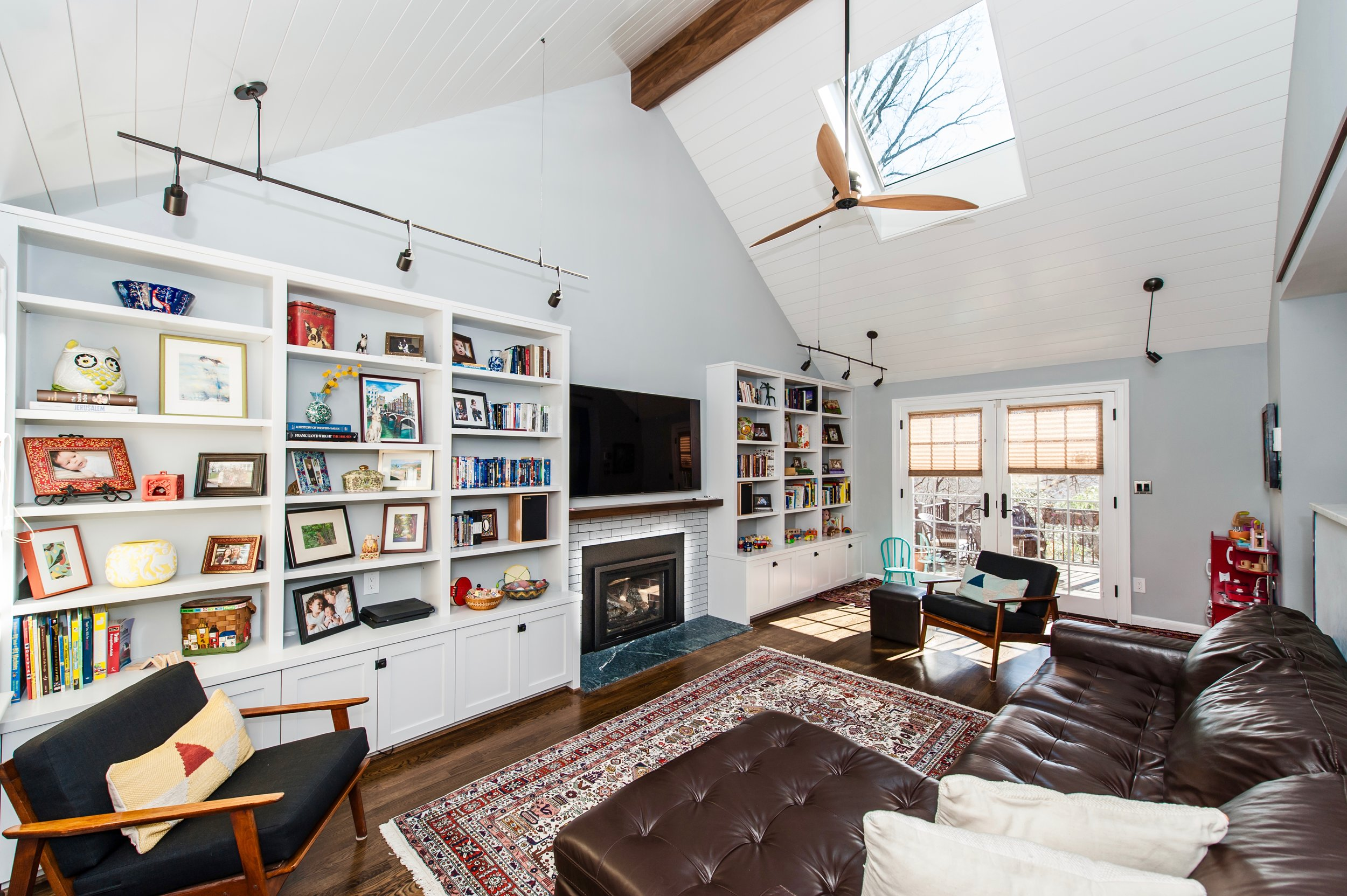 Family Room Renovation with new skylights, shelves, and new raised ceiling