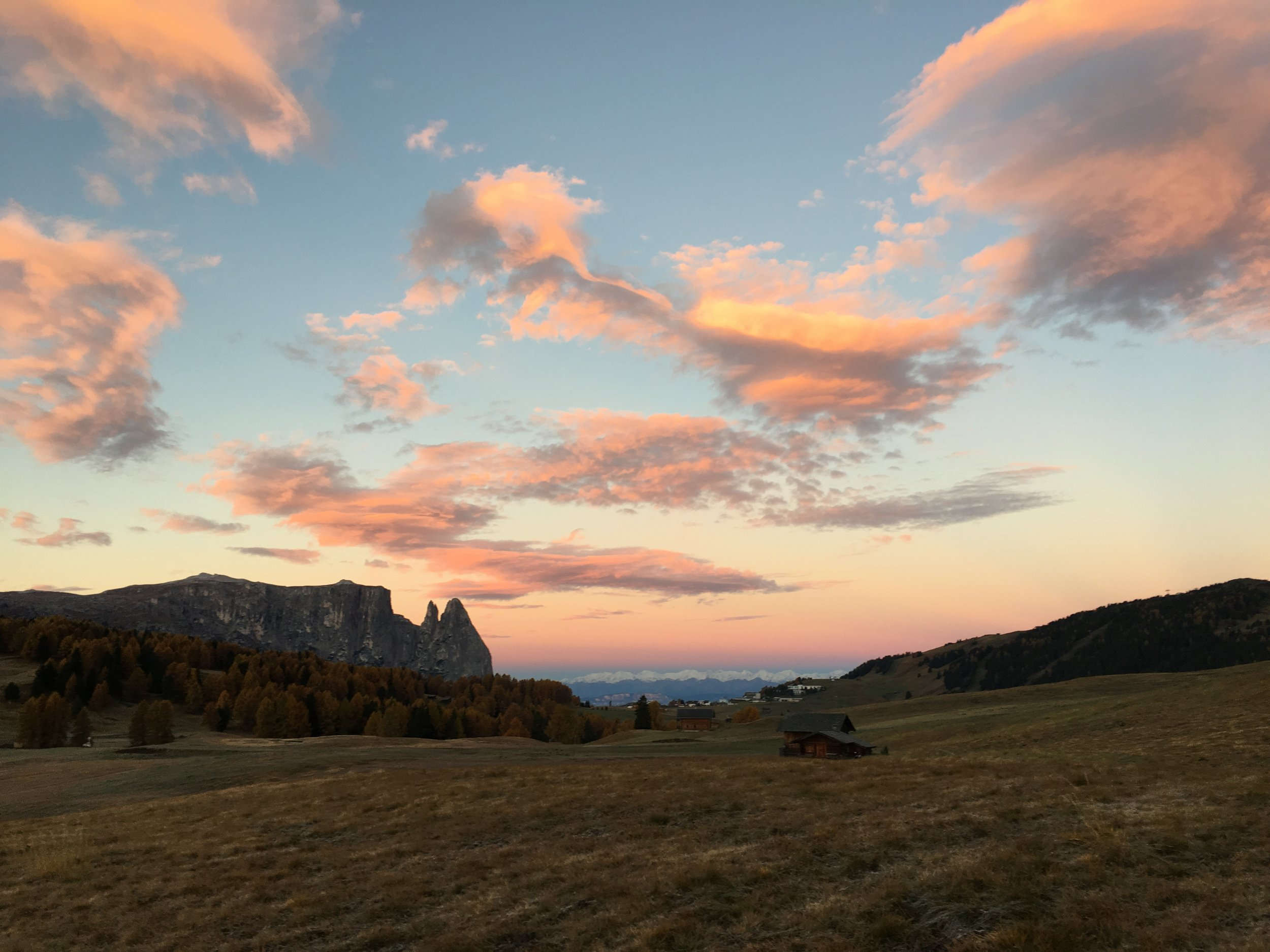 The cotton candy clouds over the Dolomites.