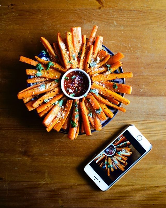 A picture of a picture of Carrot Fries. 🥕🍟 📱The saucy behind-the-scenes action you've all been waiting for. 😉#foodieforeigner#spring#eatclean#green#f52grams#food#snack#nom#carrots#frenchfries#fries#orange#color#nikon#d800#foodphotography