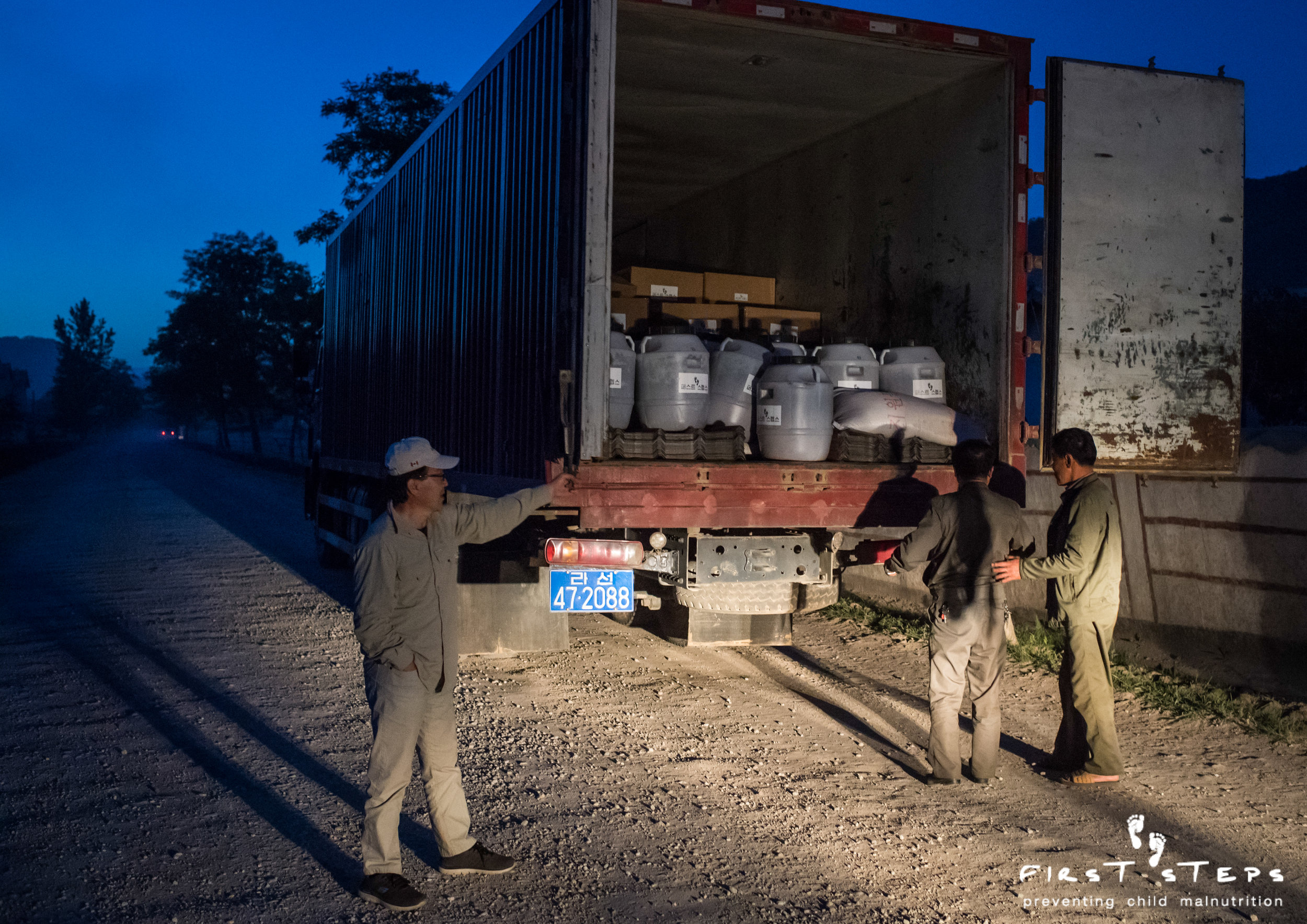 A truck carries First Steps' food aid and roofing to Yonsa.