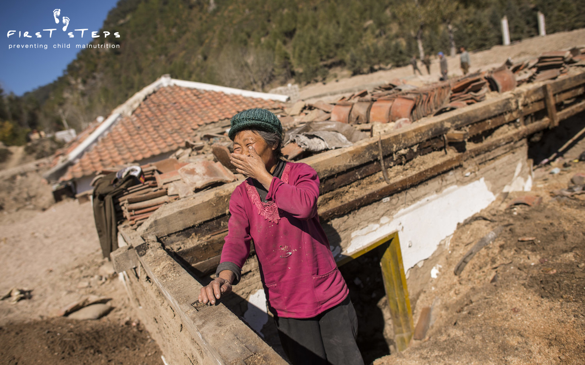"""Everything turned into a sea for three days."" Shin Bong-Suk(65) stands in the ruins of the home where she and her family lost all their personal belongings and household assets."