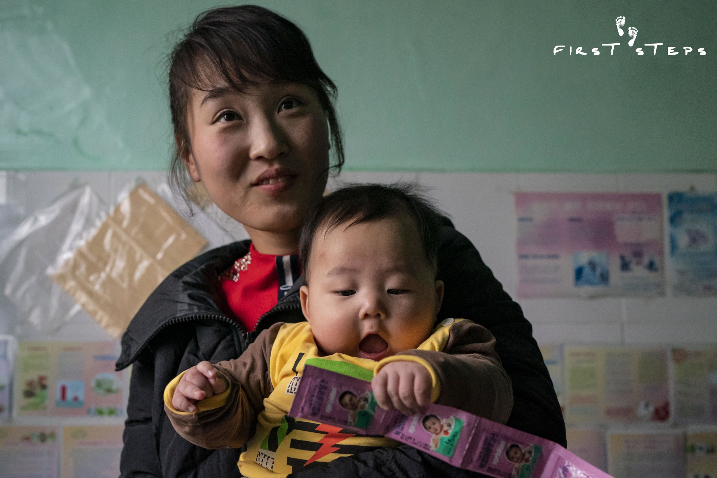 Sprinkles – the pink sachets in baby Kuk-Bin's hands – are a micronutrient powder that prevents mineral and vitamin deficiencies in pregnant women, nursing mothers and young children.