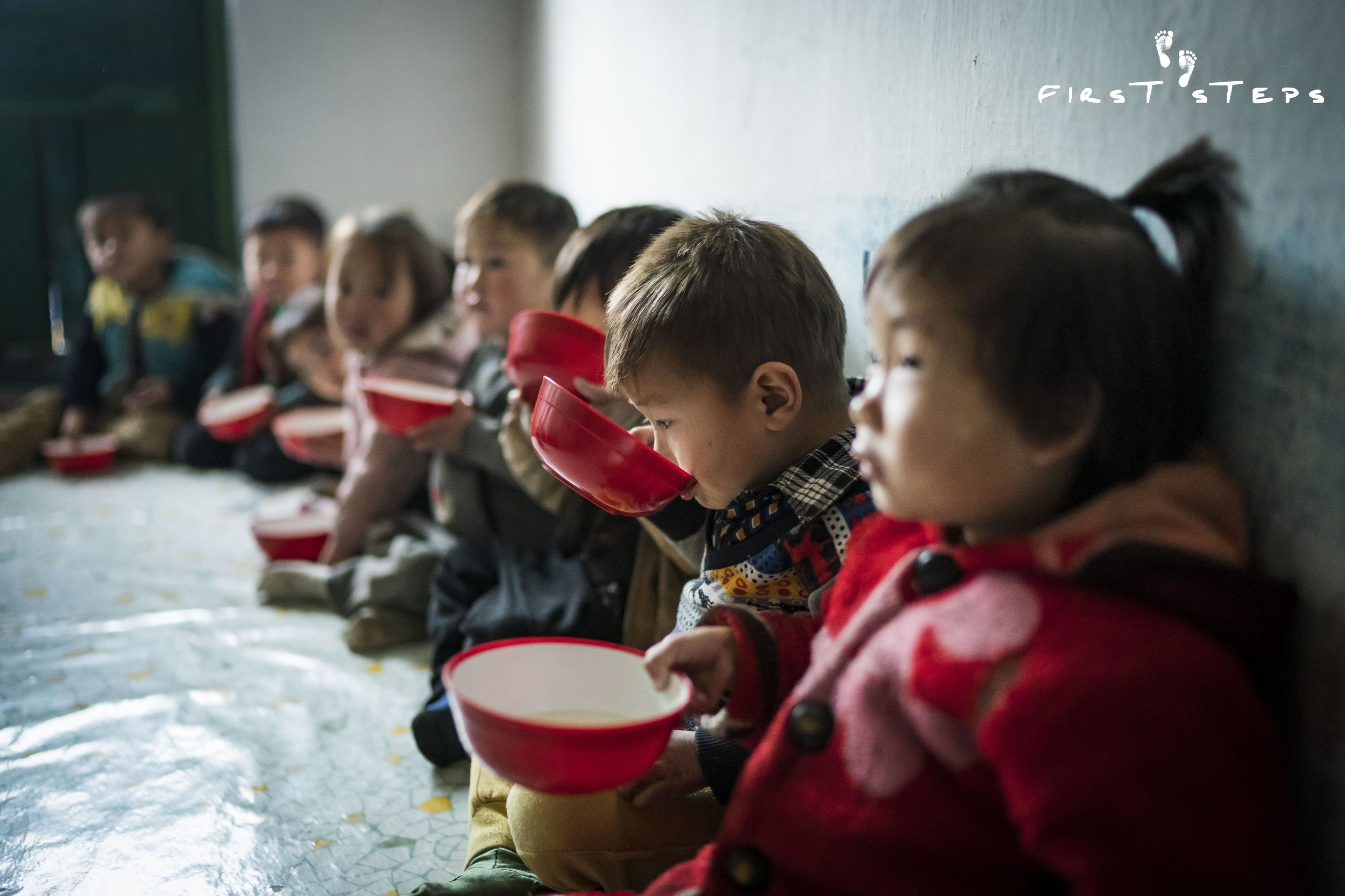 The children at the Rosang-Ri #1 Daycare slurp up their soymilk quietly and contentedly.