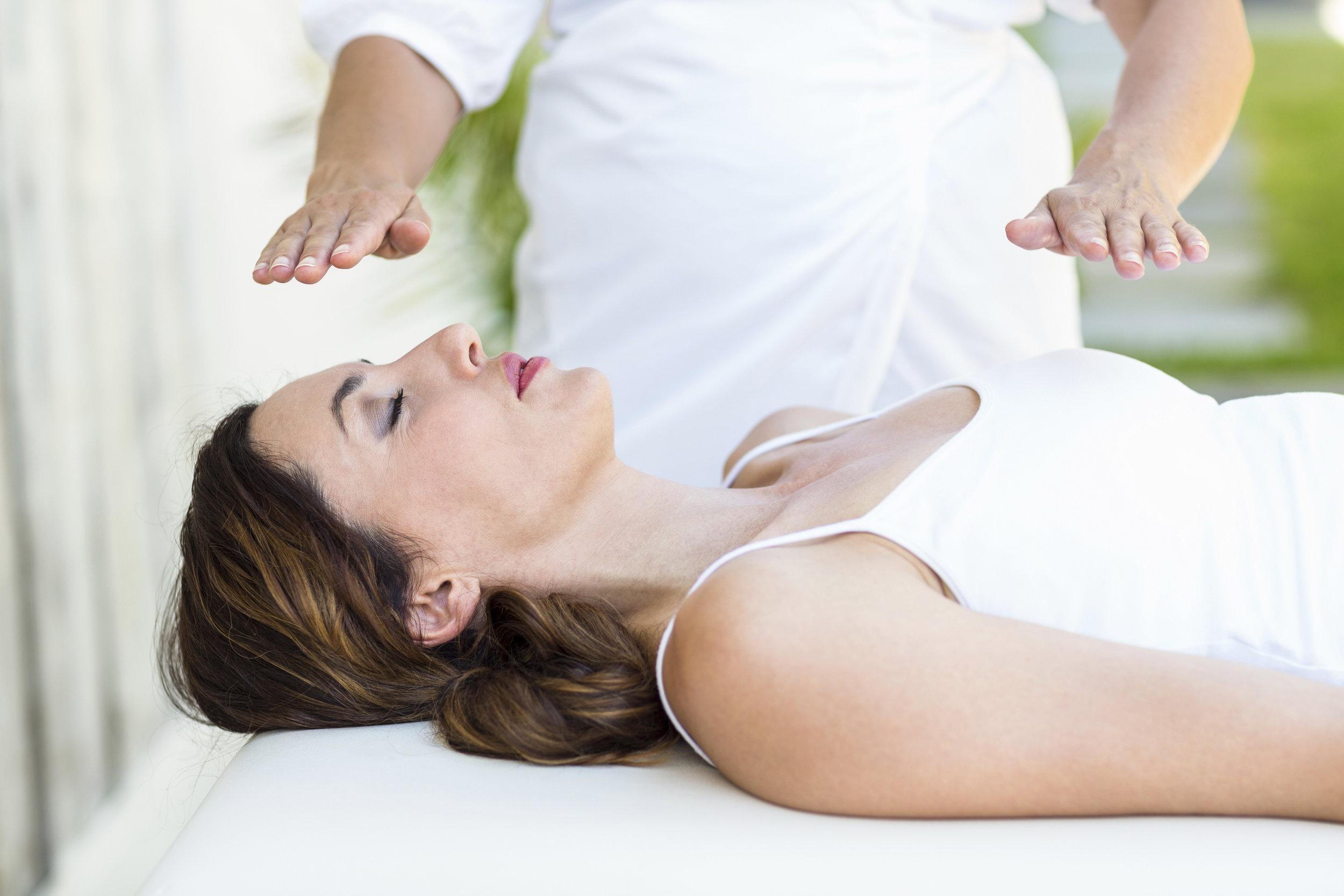 Calm-woman-receiving-reiki-treatment-000072921833_Large.jpg