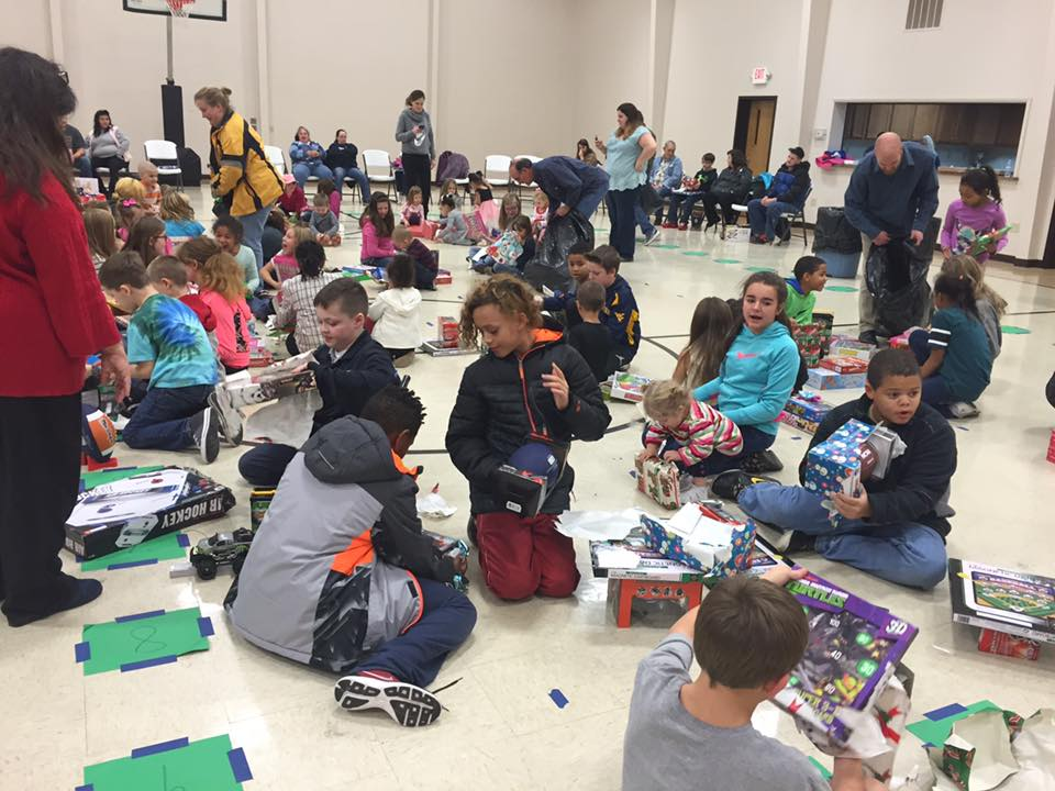 Children's & Youth Christmas Party - Dec. 21, 2016  We partnered with Toys for Toys to provide over 75 students (youth and children) with multiple Christmas presents. We were also blessed to give away a box of food to each family!