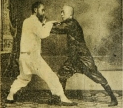 Chen Wei Ming, student of Yang Chen Fu, practicing Push Hands with a student