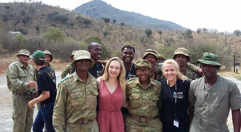 Olivia Taylor and Josephine Crouch stand next to the legendary Reginah Mogwera. A game warden and rhino anti-poaching hero.